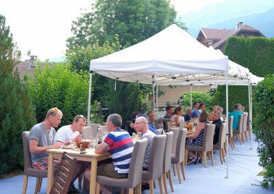 Guests having dinner in garden