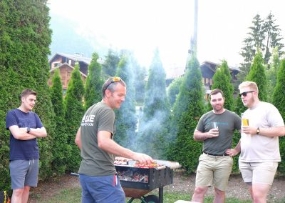 Men cooking on barbecue