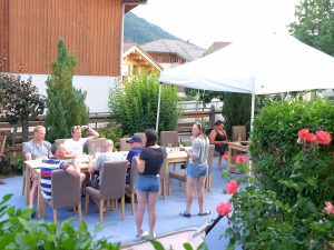 Guests enjoying a barbecue in the garden