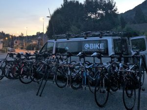 Road bikes on a rack by a minibus