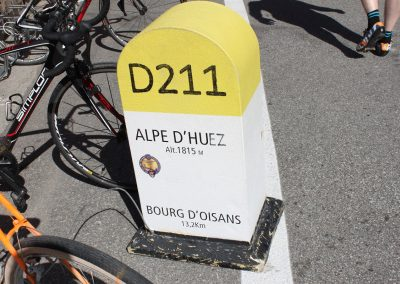Road marker for the summit of Alpe d'Huez mountain climb